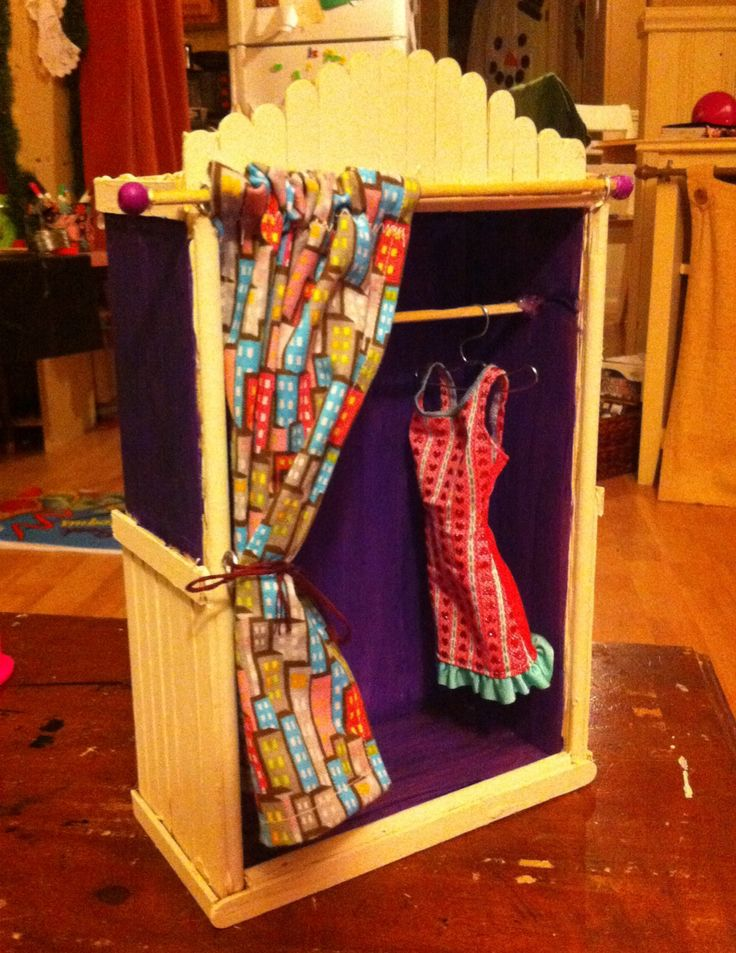 Wardrobe for barbie clothes.  Wooden box, dowels and Popsicle sticks