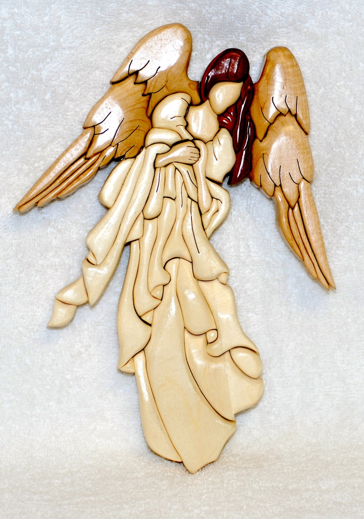"Angel.   52 pieces. Approx. size 8""x11"".        Made of Maple, Cedar, Aspen & Basswood."