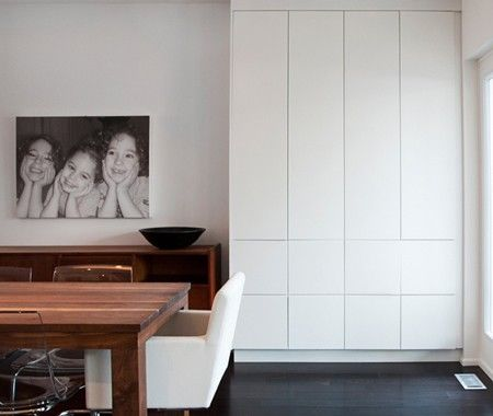 """Save by using big box store cabinets in creative ways instead of doing custom built-ins. """"Here, we used Ikea kitchen pantries to create sleek extra storage in their open-concept family dining room""""."""