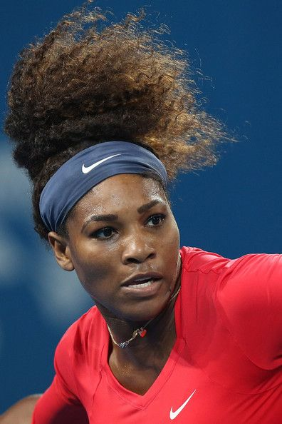 Serena Williams of United States in action during her match against Alize Cornet of France on day three of the Brisbane International at Pat Rafter Arena on January 1, 2013 in Brisbane, Australia.