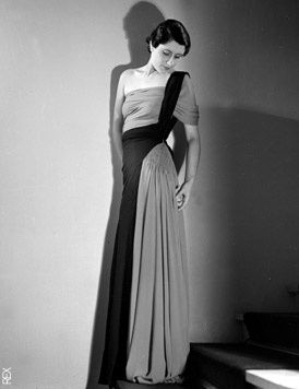 "This is Madeleine Vionnet. Born in 1876, a seamstress at the age of eleven, she eventually became one of the most influential fashion designers of the 20th century with her famed ""House of Vionnet"" which opened in 1912 and operated through the late 1930′s. Karl Lagerfeld, John Galliano, Christian Dior, Azzedine Alaia and Cristobal Balenciaga all name Vionnet as a major influence."
