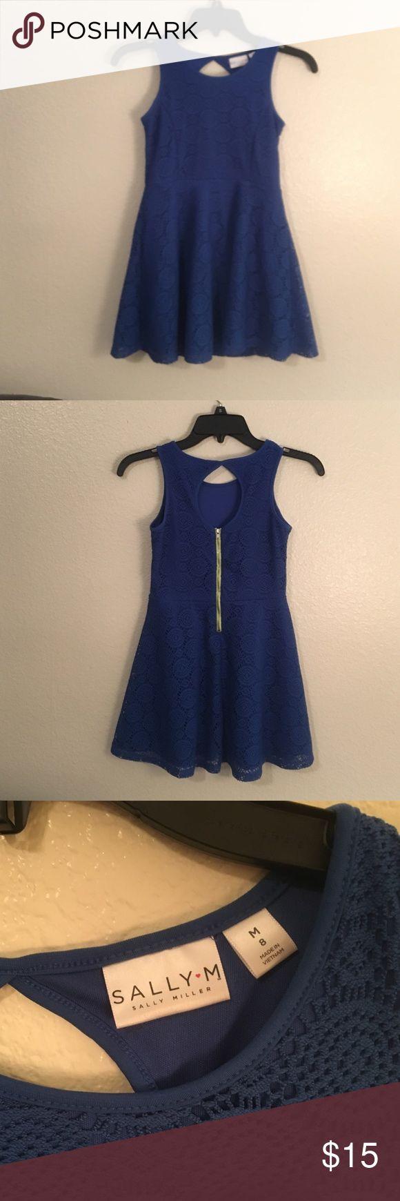 Girl's size 8 blue dress by Sally Miller Sally Miller sleeveless dress. Girls size 8 (medium). Beautiful royal blue crochet style overplayed on blue slip. Fashion zipper is yellow/ green. Sally Miller Dresses