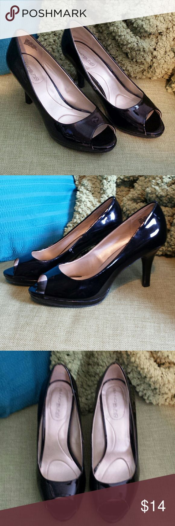 Black peep toe heels Bandolino black heels. Cute peep toe. Some scuffs and signs of wear, but still look great overall. Bandolino Shoes Heels