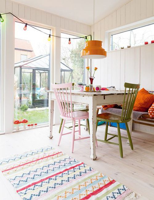 bright, colorful breakfast nook. in love with this rug. does anyone know where it's from?