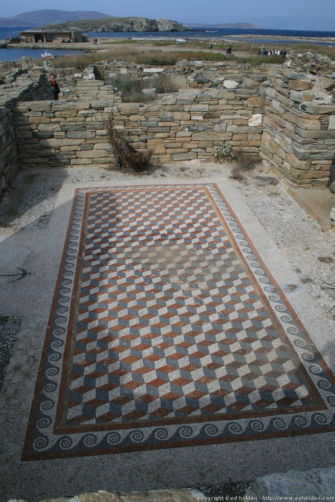 This ancient ruin in Greece is identical to the Olde English Grafham design - see it here: https://originalfeatures.co.uk/tileshop/olde-english-tiles/tiledesigns/grafham.html