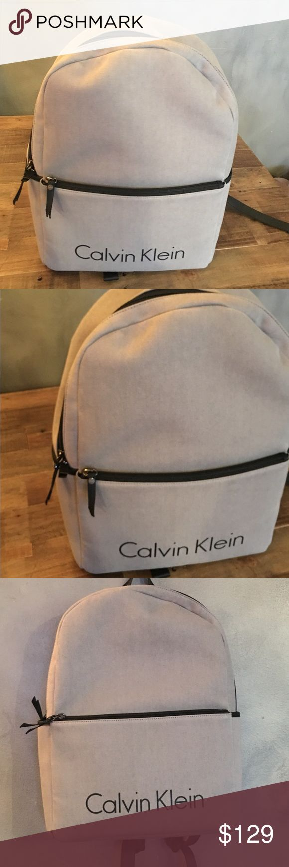 """NWT Calvin Klein man's backpack Stunning , super trendy and stylish backpack by Calvin Klein. New with tag modern backpack designed with a canvas body, faux leather trim, a zip main compartment and inteior storage for a lightweight, on-the-go style. Canvas + faux leather top handle + adjustable shoulder straps zip compartment + front zip pocket side pockets interior open compartment fully lined FABRIC + CARE canvas + faux leather imported FIT + SIZING 16"""" wide x 11.75"""" tall x 5.5"""" deep…"""