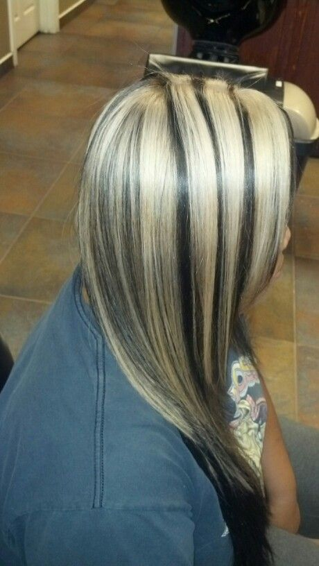 Blonde thick highlights with a dark brown base