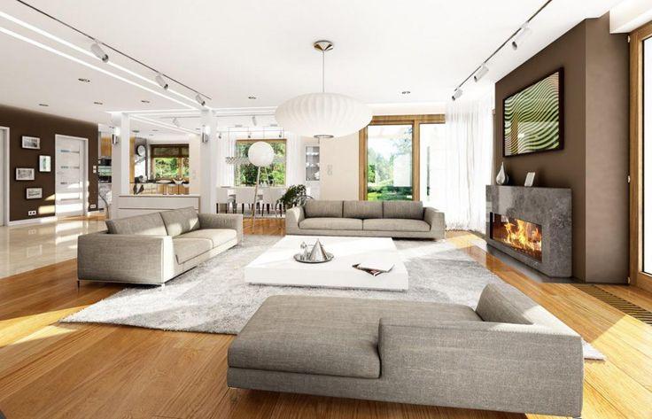Kominek i drewniana podłoga świetnie ocieplają przestronne wnętrze salonu. Projekt: Wiola. Fot. MG Projekt