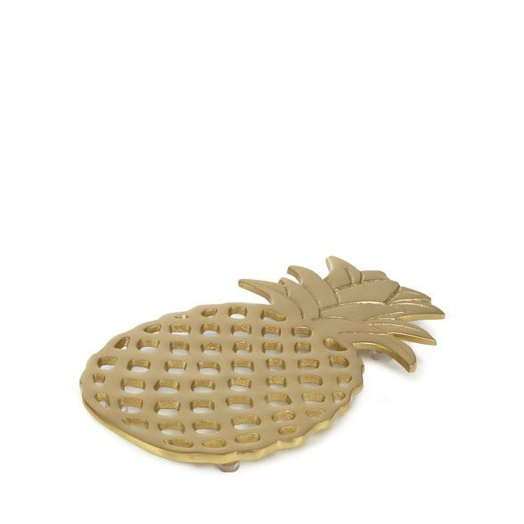 Add a tropical twist to your home with this trivet from At home with Ashley Thomas. In a gold hue, it is perfect for keeping hot dishes raised off a surface.