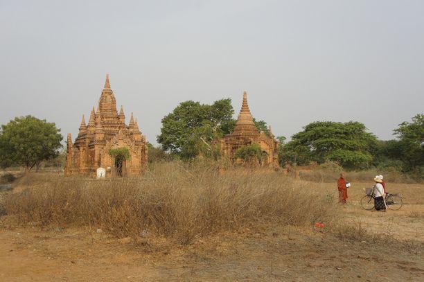 Old Bagan, Myanmar — by Earthseeing. A monk and some locals having a meeting in Old Bagan, Myanmar. #bagan #burma #monks #locals #ruins