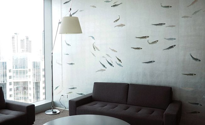 Modern chinoiserie 'Fish' by Misha wallpaper: Designer DLArchitecture featured hand painted wallpaper Fish on Silver Leaves silk in the client's office in Shaghai, China.