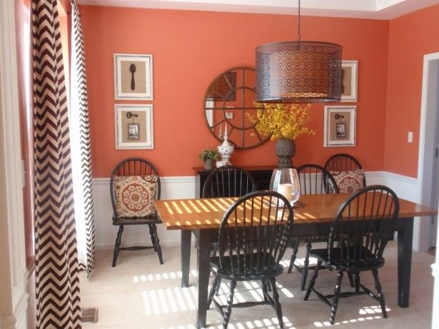 Big Drum Pendant Lamp Above Black Wooden Dining Table Set Paired With Red Wall Paint Also Zigzag Window Curtains Design