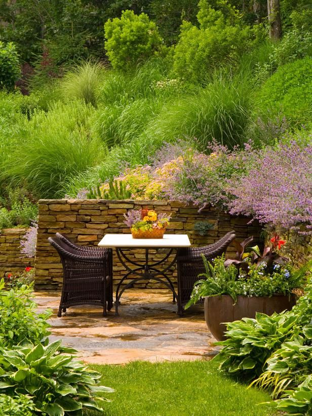 Pictures of Mediterranean-Style Gardens and Landscapes: A hidden nook off the main patio area creates an intimate sitting area surrounded by lush perennial color and grasses. Tip: Grasses will almost give a voice to your garden as they softly rustle in the wind, providing a very peaceful and relaxing atmosphere. Design by Barry Block. From DIYnetwork.com
