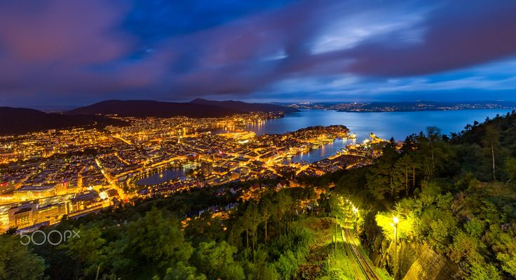 Bergen By Night - Long exposure of the beautiful city of Bergen, Norway by night. I love how the funicular tracks leads the eyes towards warm glowing city.