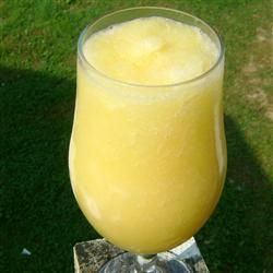 Fuzzy Navel Slush With Water, White Sugar, Frozen Orange Juice Concentrate, Frozen Lemonade Concentrate, Peach Schnapps, Lemon-lime Soda