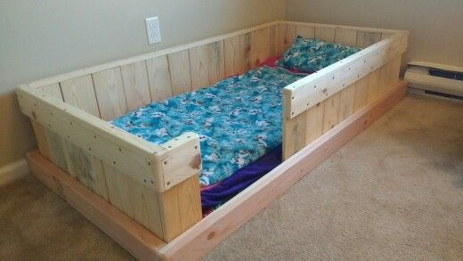 Toddler bed made out of fresh pallet wood.