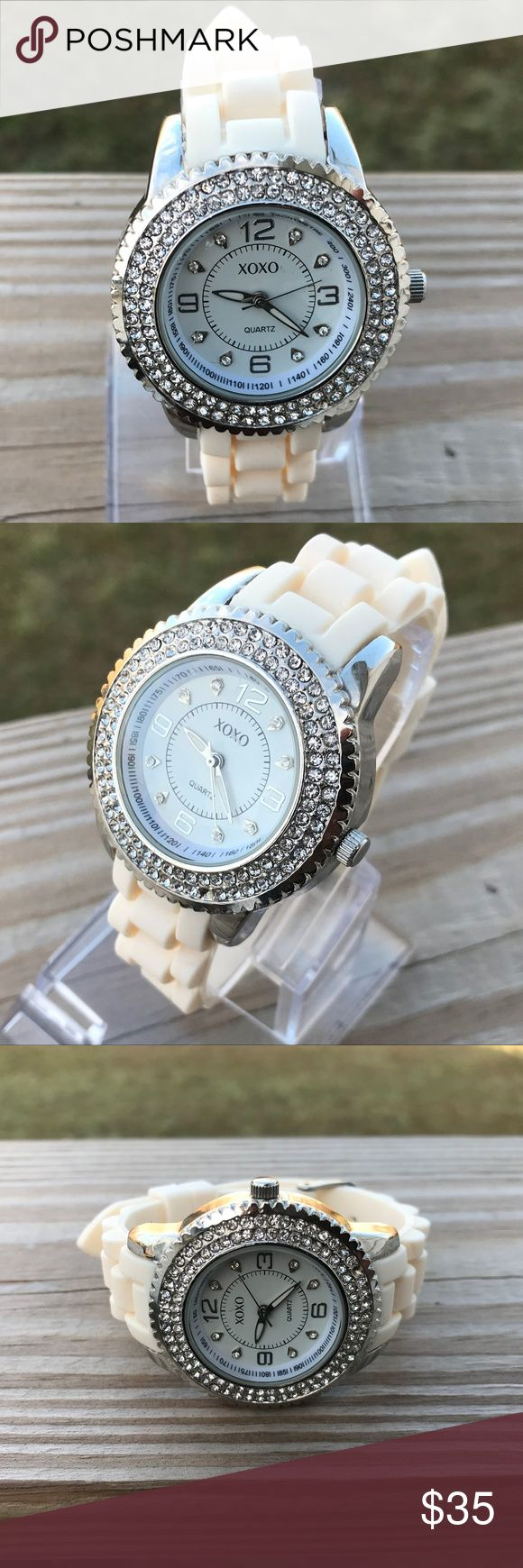 XOXO Women's Watch White Silicon Rubber Band Silve XOXO Women's Watch White Silicon Rubber Band Silver Case Wrist Watch Japan Movt  Brand: XOXO  Color: White + Silver  Size: belt ( adjustable )  Japan movement Stainless Steel Back  New without tags, never used. XOXO Accessories Watches