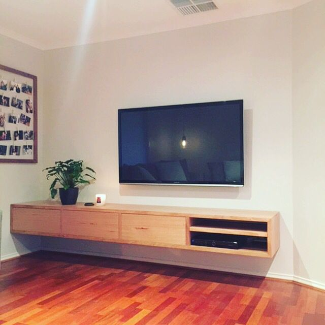 Floating TV unit made from Vic Ash timber with push to open drawers