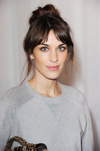 Alexa Chung - messy up do, grey sweat shirt + leopard print