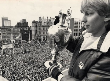 Gary Shaw shows the chapionship trophy to Aston Villa's doting legions in 1981.
