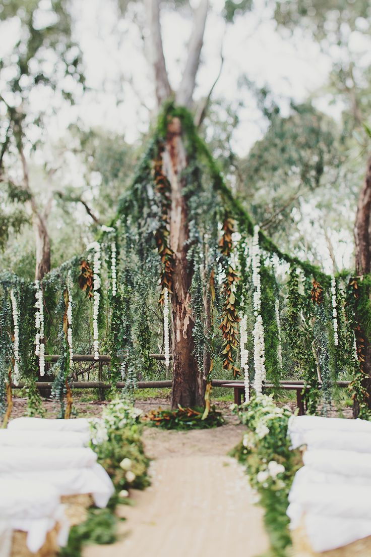 Twilight-esque wedding backdrop with lots of greenery and white blossoms | Jiaheng and Adelene's Woodsy Wedding in Melbourne