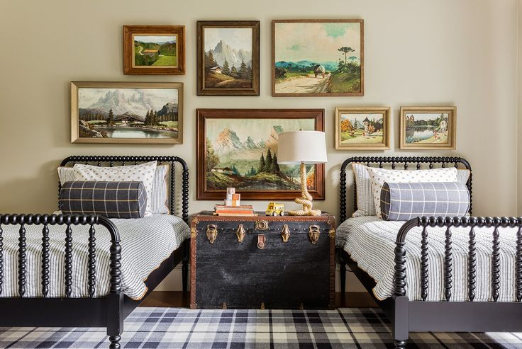 Cute room - love the Jenny Lind beds, trunk and plaid rug, swap the art for something more fun and its a great kids room!