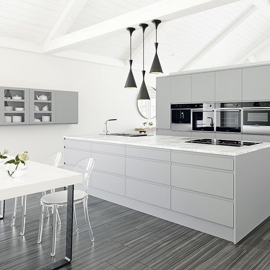 Gray And White Kitchen Designs luxury white kitchen with marble island hanging pots and pans and hardwood flooring Grey Kitchens Dont Have To Be Dark And Gloomy This Grey And White Mix Of