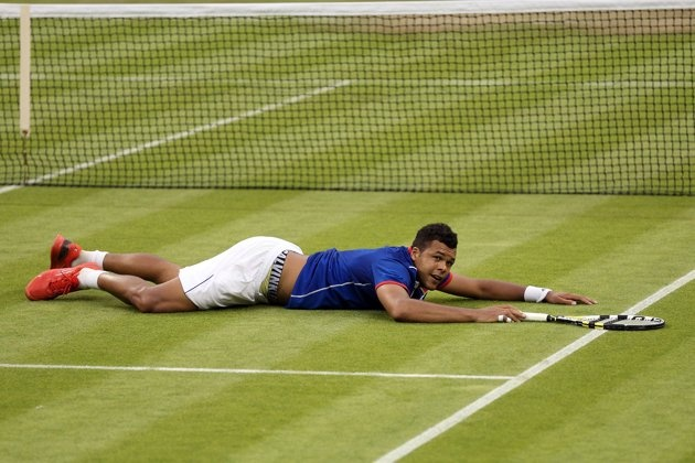 Olympics: Day Two - JULY 29: Jo-Wilfried Tsonga of France celebrates match point during the Men's Singles Tennis match against Thomaz Bellucci of Brazil on Day 2 of the London 2012 Olympic Games at the All England Lawn Tennis and Croquet Club in Wimbledon on July 29, 2012 in London, England. (Photo by Clive Brunskill/Getty Images)