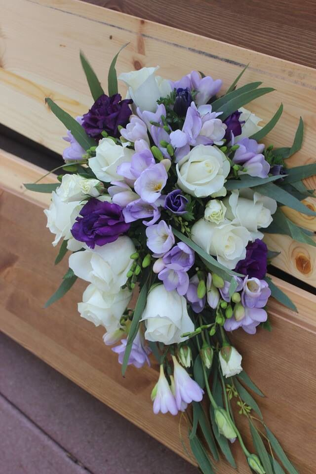 Short cascade purple and white bridal bouquet Roses, freesia, lisianthus and seeded eucalyptus  Four Leaf Clover Designs NEPA