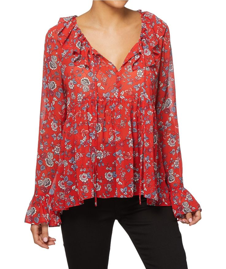Edge up your inner bohemian with the V Neck Ruffle Blouse. This lightweight semi sheer woven top features all over print, V neckline with tassel and ruffle trim.