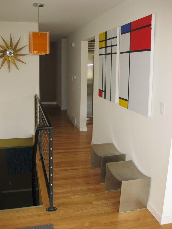 Contemporary Hallway with Hardwood floors, Pendant light