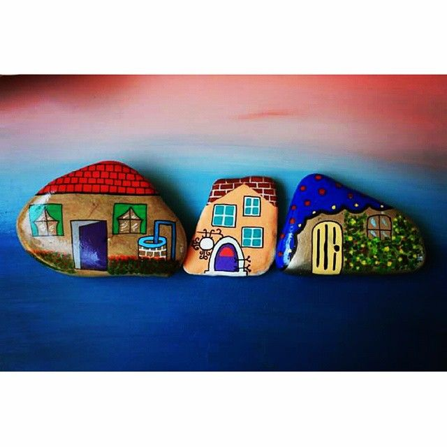 Cute little painted stone cottages!