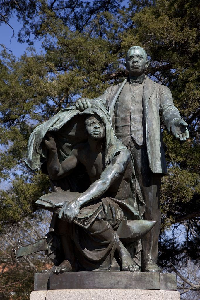 "A photo of the ""Lifting the Veil of Ignorance"" Monument featuring Booker T. Washington. The monument is located at Tuskegee University and was unveiled and   dedicated in front of 100,000 African-Americans on April 15, 1922."