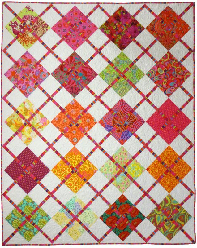 We can't get over how cute this argyle quilt is! This colorful quilts would be perfect in a guest room or as a living room throw.