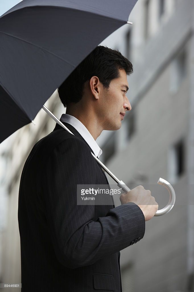 side-profile-of-businessman-holding-umbrella-picture-id89446901 (682×1024)