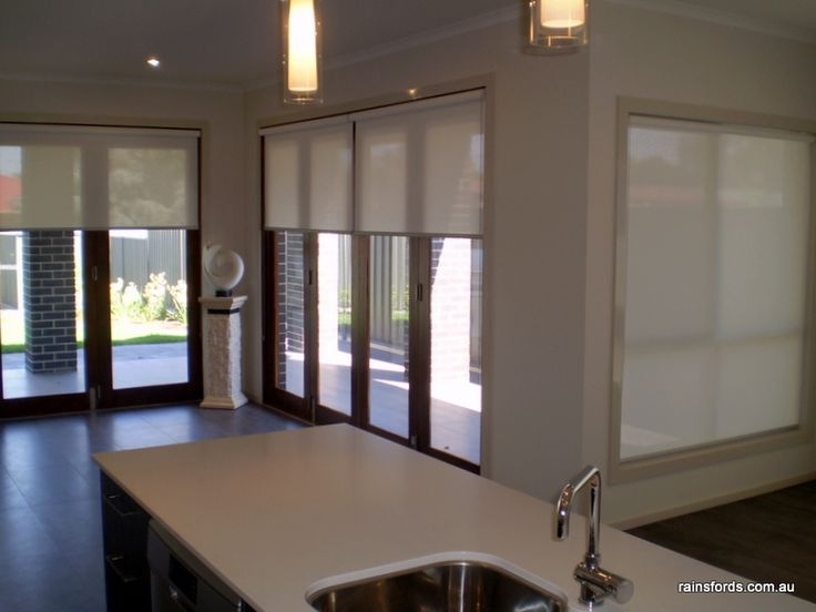 roller blinds over bifold doors by rainsfords adelaide