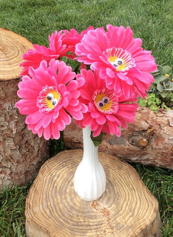 Paste some wiggly eyes onto plastic flowers!  Alice in Wonderland Decorations Decor Tea Party by MadInWonderland