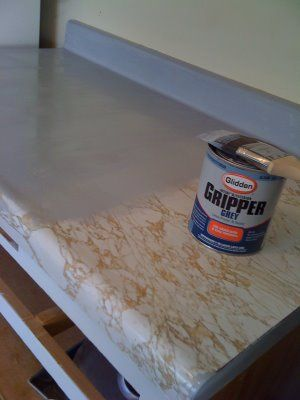 Rocky Bella: Before & After: Painting My Countertops - perfect for the outdated countertop in the bathroom.