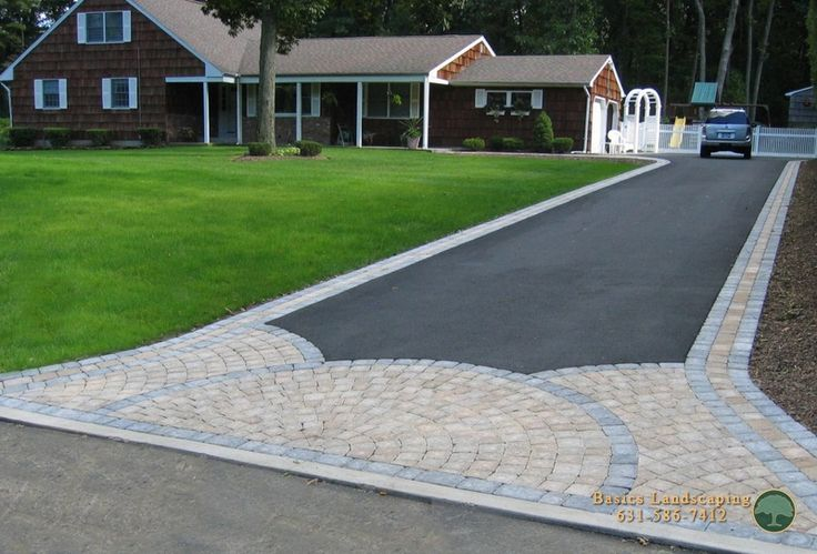 driveway with paver apron and borders pave stone walks
