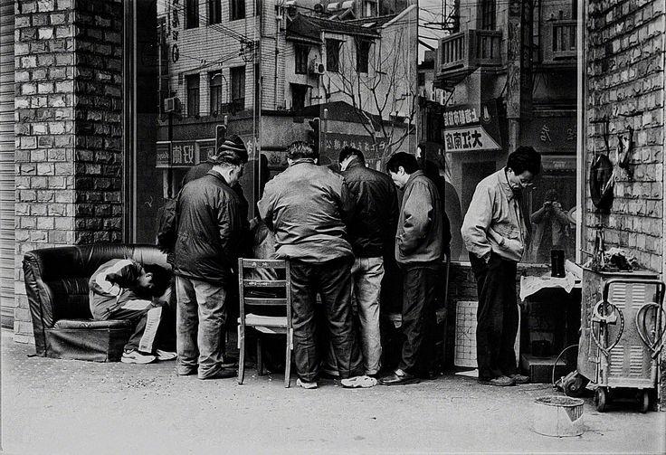 Players, men, whiling away the time. Playing Mah Jong at a street corner, in FuJian Lu, Shanghai
