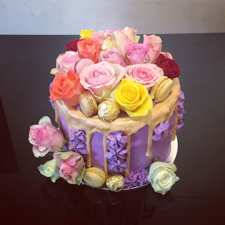 Gold Drip cake with fresh flowers, macaroons and Ferraro rochers for a christening