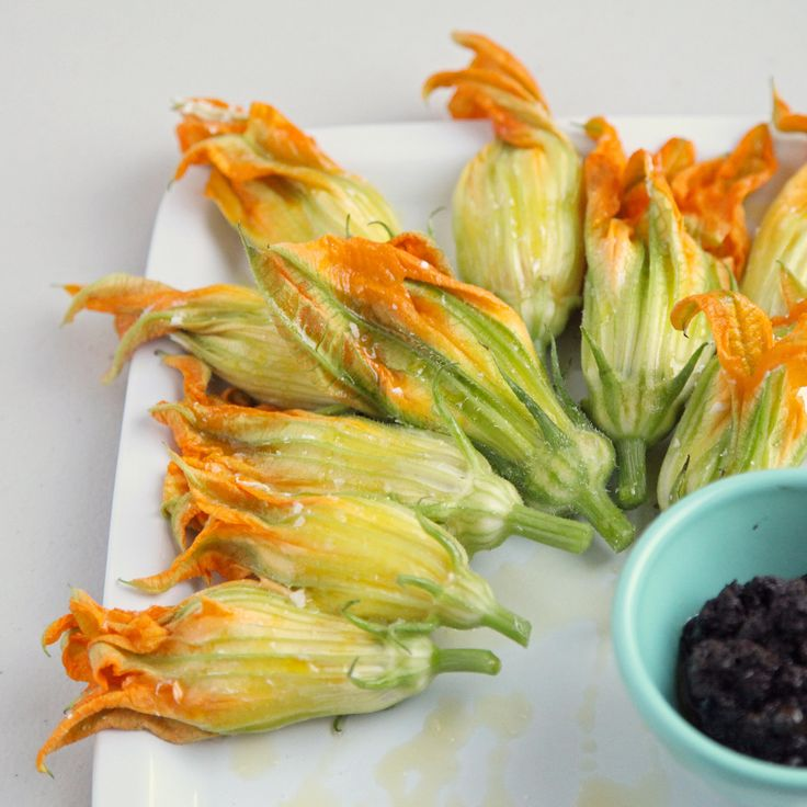 Killer App: Burrata-Stuffed Squash Blossoms With Olive Tapenade (subtract the anchovies, bleh)