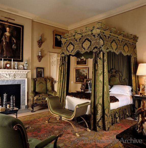 The Grand Four Poster Bed Is Draped In Green And Gold