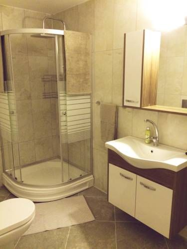 Duran Homes Marmaris Featuring air conditioning, Duran Homes offers accommodation in Marmaris. Marmaris Thursday Market is 300 metres away. Free WiFi is provided throughout the property.  All units have a seating area with a satellite flat-screen TV and DVD player.