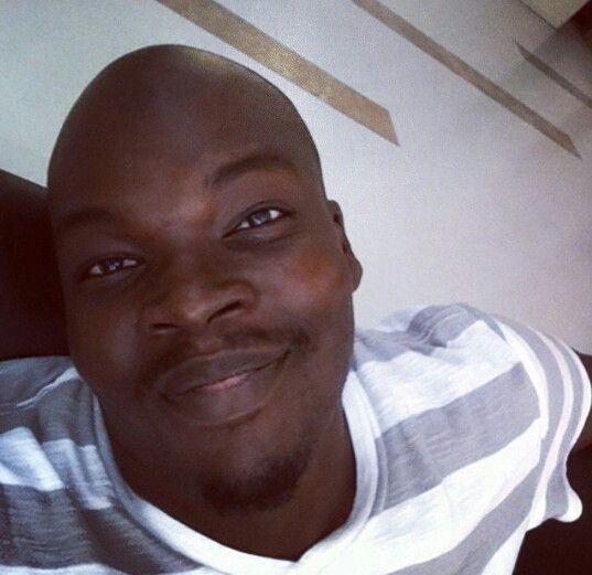 bald black man