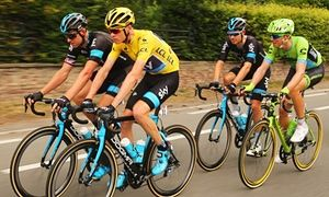 Chris Froome of Team Sky rides alongside Ian Stannard during the early part of stage four of the 2015 Tour de France, on route to Cambrai.