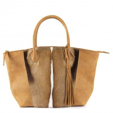 BOK BOK TOTE HANDBAG BROWN Stylish yet practical. This is a great bag for travelling or just getting out & about. Featuring natural springbok on the front and saddle stitched distressed, diesel, butterscotch leather on the back. It also has a beautiful soft, long detachable leather tassel. As each bag is handmade from hide and distressed natural leather, it is to be expected that, there will be some variations in colour and texture.