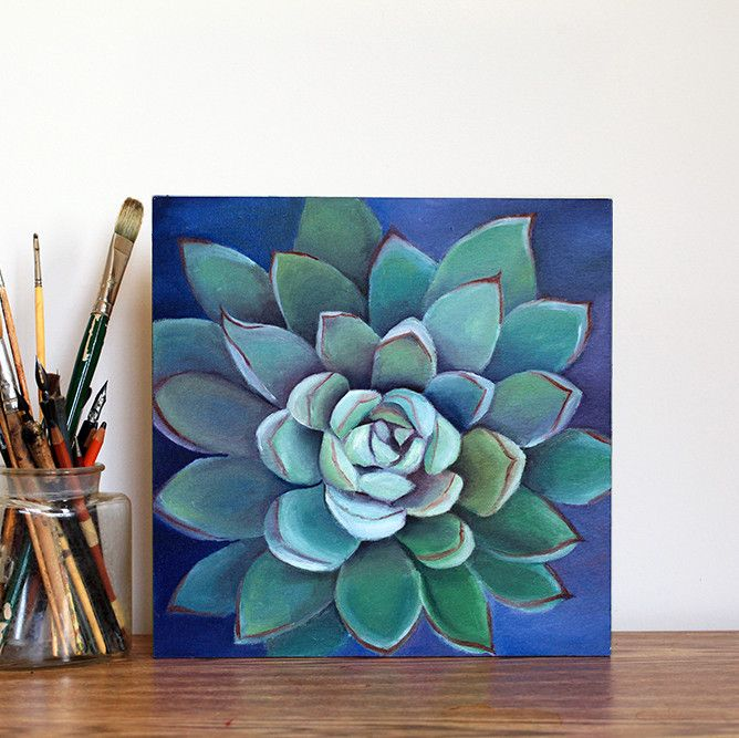 "This 12x12 original oil painting of a gorgeous green and purple succulent is ready for your walls or to be placed on a shelf or table. The 3/4"" edges of the canvas have been painted purple to match th"