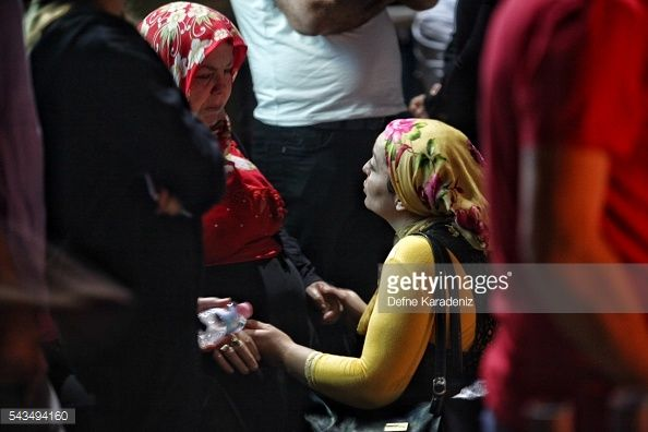 Relatives of the Ataturk Airport suicide bomb attack victims wait outside Bakirkoy Sadi Konuk Hospital, in the early hours of June 29 in Istanbul, Turkey. Three suicide bombers opened fire before...