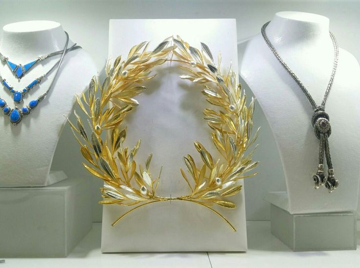 Real Olive wreath with gold and silver filling #housewares #homedecor #etsy #gold #silver #olivebranch #wreath #greece #symbolofpeace #madeingreece http://etsy.me/2hN522O